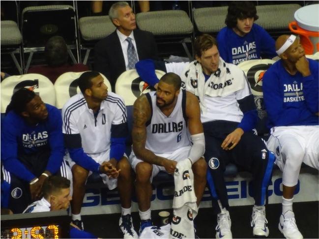 Dallas Mavericks Tyson Chandler and Dirk Nowitzki on the bench during Memphis Grizzlies preseason game October 20, 2014. Mandatory Credit - Matt Thornton