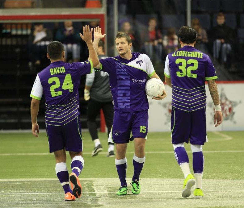 Dallas Sidekicks Shaun David, Cameron Brown, and Jamie Lovegrove congratulate each other after a goal vs Tulsa Revolution.  Mandatory Photo Credit Cherie Callaway
