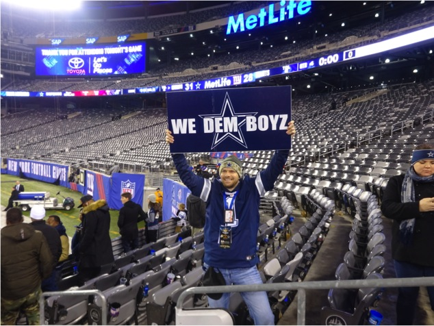 Matt Thornton holds a We Dem Boyz Dallas Cowboys sign after the Cowboys defeated the New York Giants at MetLife Stadium November 23, 2014. - Mandatory Photo Credit Clara Russell Dallas Entertainment Journal