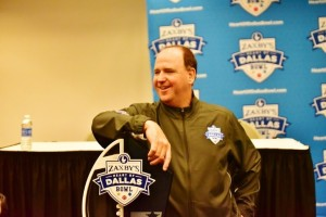 ouisiana Tech head Coach Skip Holtz poses with the Zaxby's Heart of Dallas Bowl trophy. (Action Sports and News/Greg Collier)