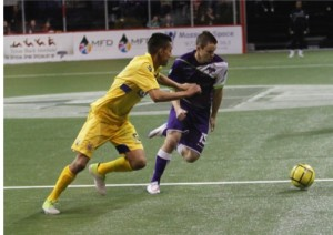 Dallas Sidekicks Cameron Brown steals the ball from an Oxford City FC of Texas defender.  Mandatory Photo Credit Mike Perry