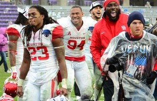 (from L-to-R) Houston Junior defensive back Trevon Stewart and  sophomore defensive end Cameron Makveaux celebrate moments after winning the Lockheed Martin Armed Forces Bowl 35-34 over the Pittsburgh Panthers. (InTheMoment/M.Willis)