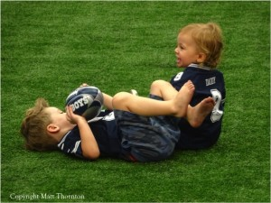 Dallas Cowboys QB Tony Romo's Sons Hawkins and Rivers Romo play on AT&T Stadium Field during Family Day - Mandatory Photo Credit Matt Thornton