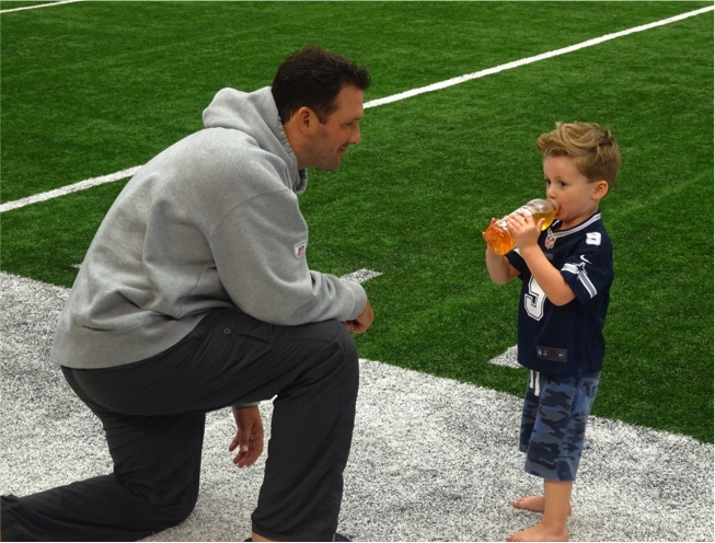 Dallas Cowboys QB Tony Romo and Son Hawkins During Family Day at AT&T Stadium - Mandatory Photo Credit Matt Thornton