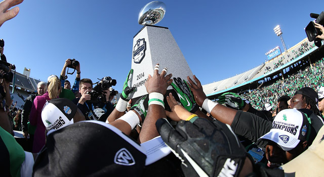 North Texas lifts the Heart of Dallas Bowl trophy after a 36-14 win on New Year's Day (photo by Rick Yeatts)