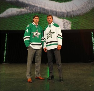 Former Dallas Stars forward Mike Modano and current forward Jamie Benn model the Stars new uniforms.