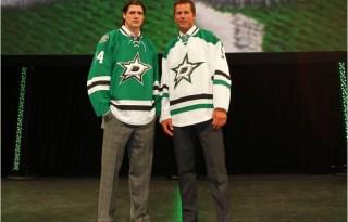 Former Dallas Stars forward Mike Modano and current forward Jamie Benn model the Stars new uniforms.